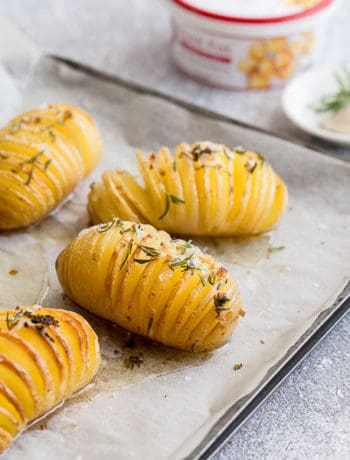 Sliced Roasted Potatoes (Duck Fat Hasselback Potatoes) - Perfect on their own, or plated up as a side, these hasselback style potatoes are roasted in duck fat for crunchy crisp perfection. Finished off with rosemary, garlic and sea salt for that classic flavour punch! | wandercooks.com #potatoes #hasselback #roastedpotatoes #wandercooks #sidedish