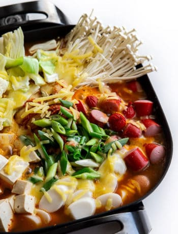 Budae Jjigae Korean Army Stew Recipe - A satisfying, cheesy hot pot full of enoki mushroom, kimchi, tofu, rice cakes and even frankfurts! | wandercooks.com #budaejjigae #koreanfood #armystew #koreanarmystew