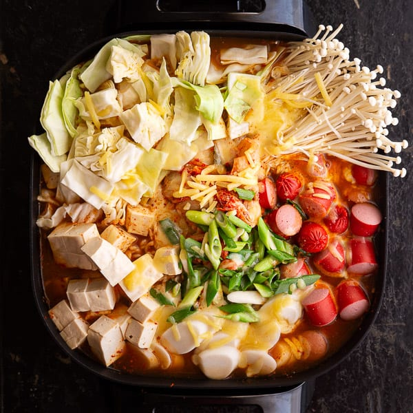 Top view of budae jjigae heated up and ready to eat.
