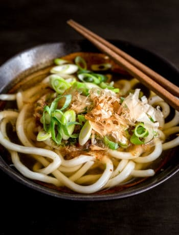 Udon noodle soup in a bowl of udon soup stock made with dashi, soy sauce and mirin.