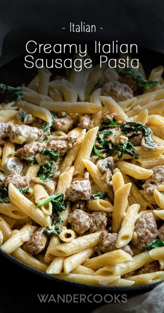 Creamy Italian sausage pasta in cast iron pan.