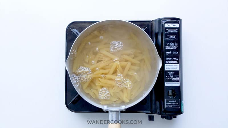 Boiling pasta in saucepan.