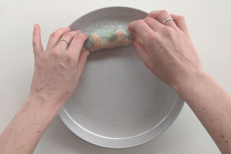 Rolling the rice paper roll.