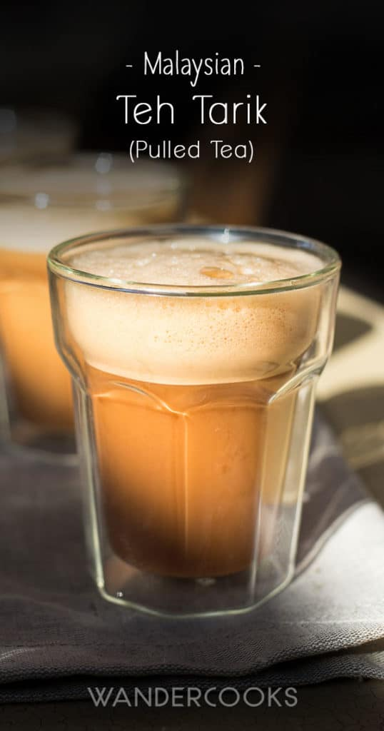 A clear glass of Malaysian teh tarik in the sunlight.