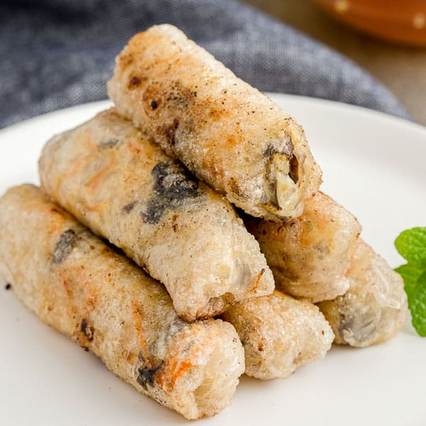 A pyramid of Vietnamese fried spring rolls on a plate.
