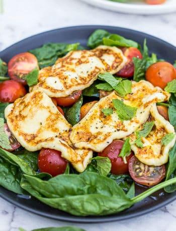 Haloumi salad on a dark plate.