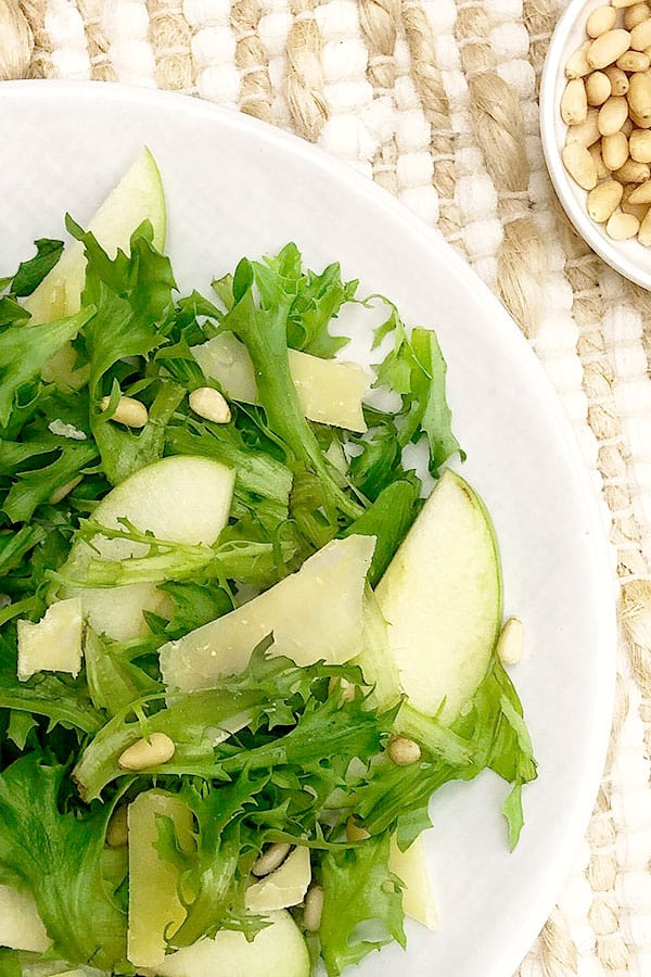 Plate of apple, rocket and pine nut salad.