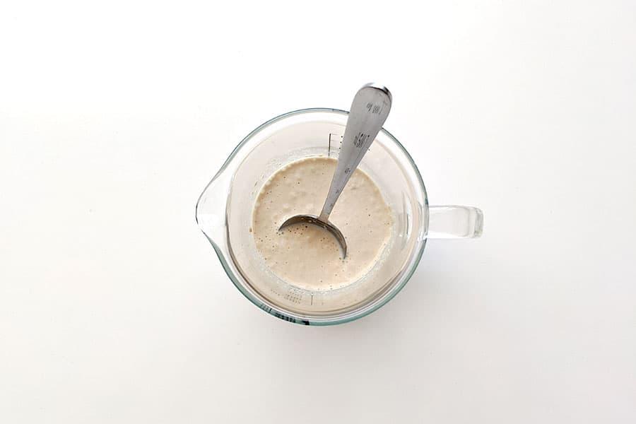 Yeast mixture activating in warm milk.