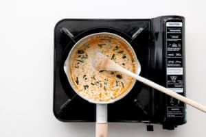 Choo chee sauce cooking in a saucepan.