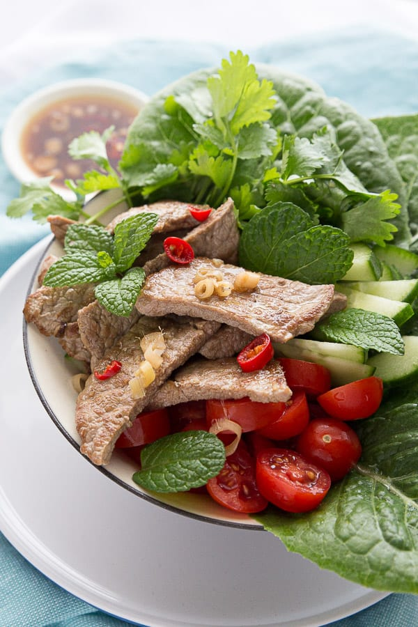 Bowl of Thai beef salad with lemongrass and mint.