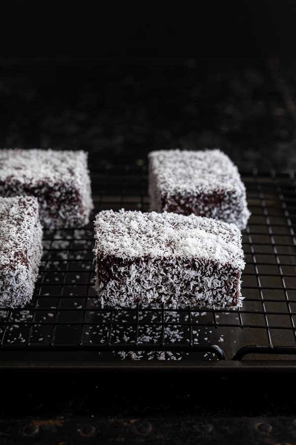 Close of up lamingtons drying on a wire tray.