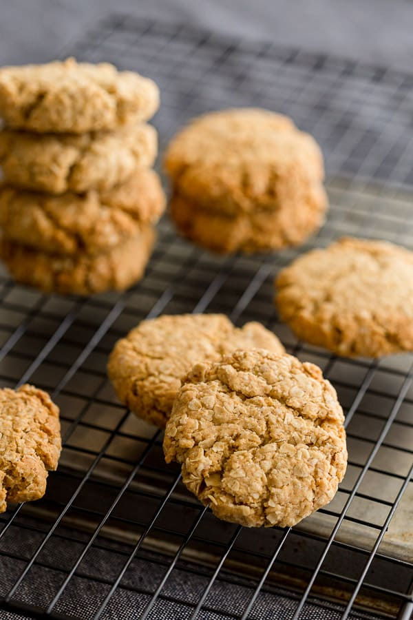 Anzac biscuits sitting on a cooling rack.