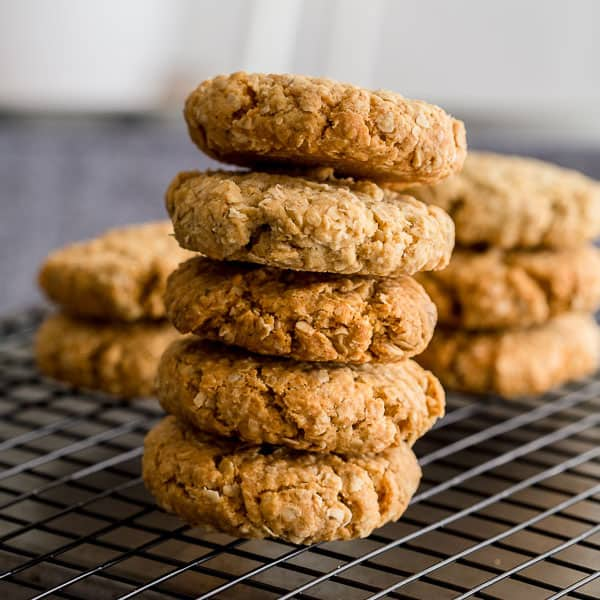 Anzac biscuits in a pile on top of each other.