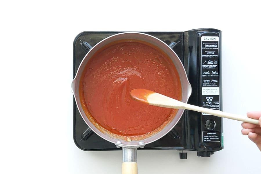 Pot of napoli tomato sauce on stove.