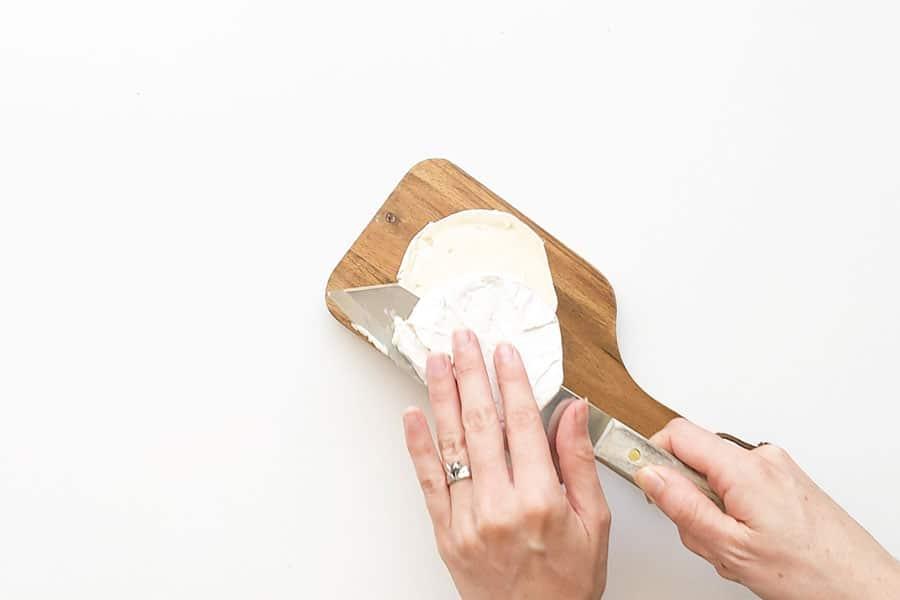 Slicing top off camembert.