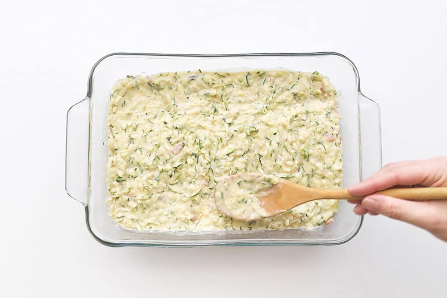 Baking dish filled with zucchini mixture.