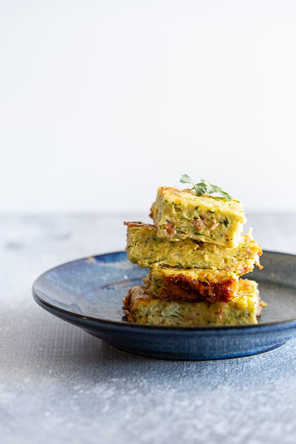 Pieces of zucchini slice on a plate.