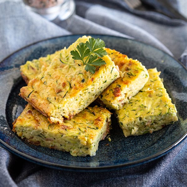 Stack of zucchini slice on plate.
