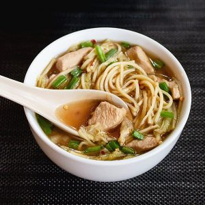 A bowl of Chinese chicken noodle soup.