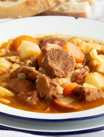 Close up of meat and vegetables in a soup known as goulash.
