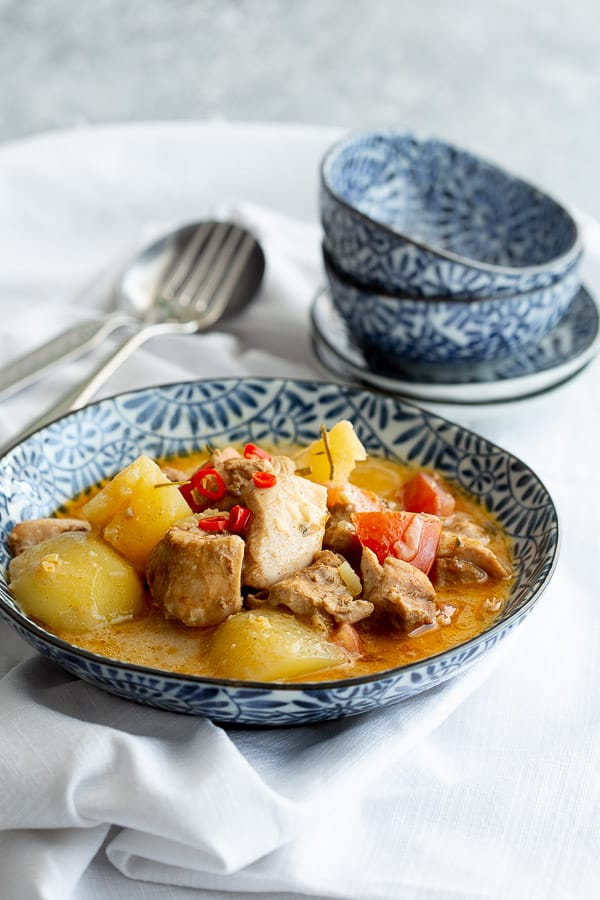 Blue bowl heaped with hot Nyonya chicken curry.