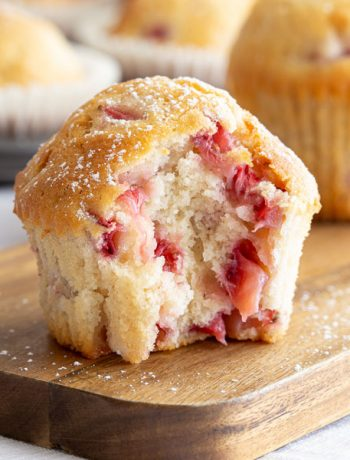 Strawberry muffin with bite to show the inside.