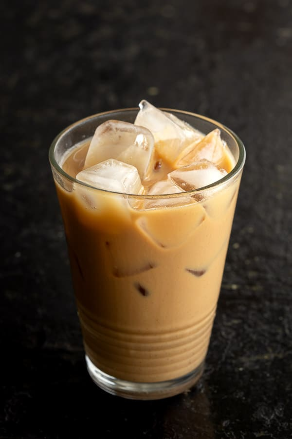 Glass of Vietnamese iced coffee filled with ice.