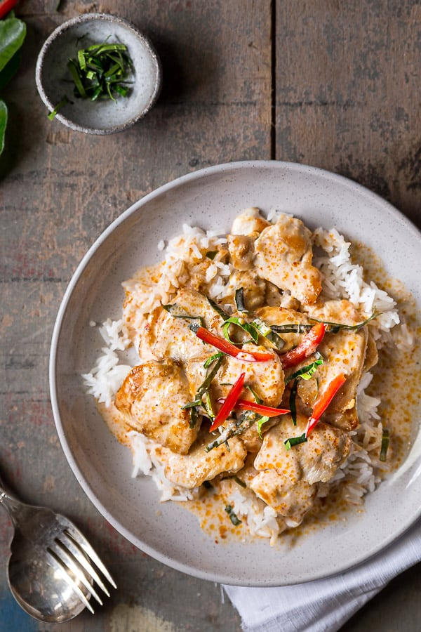 Choo chee curry on a bed of rice with chicken and kaffir lime leaves.