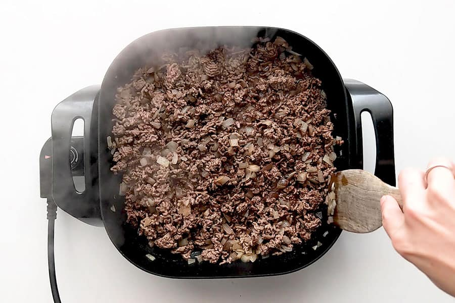 Cooking mince in a frying pan with onion.