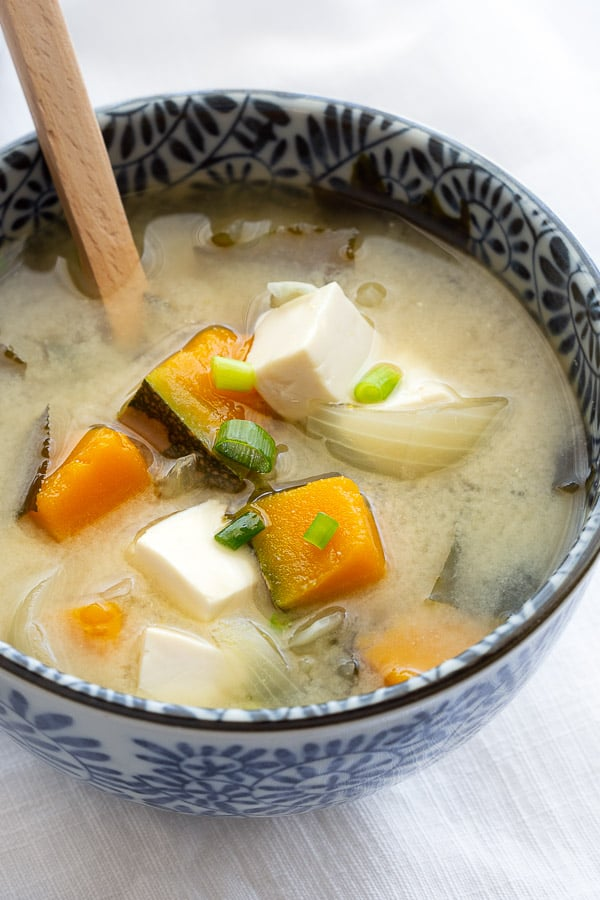 Big chunks of pumpkin and tofu in white miso soup.