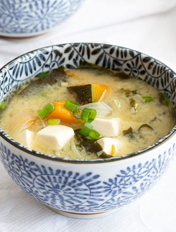 Bowl of Japanese miso soup with pumpkin and tofu.