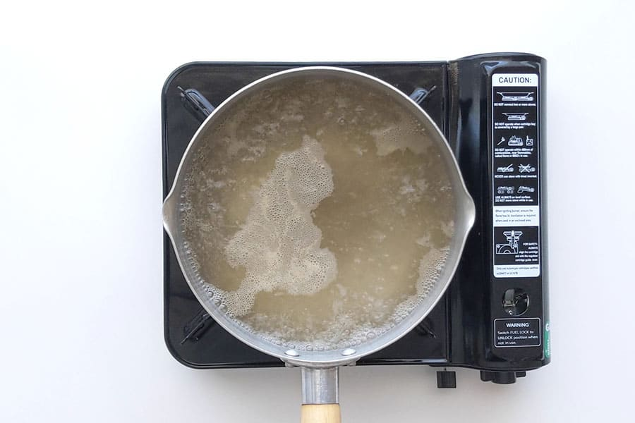 Dashi stock boiling in a saucepan.