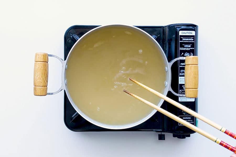 Getting the dashi broth ready for shabu shabu.