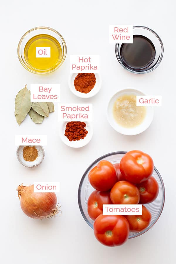Ingredients laid out for tomato pasta sauce ready to cook.