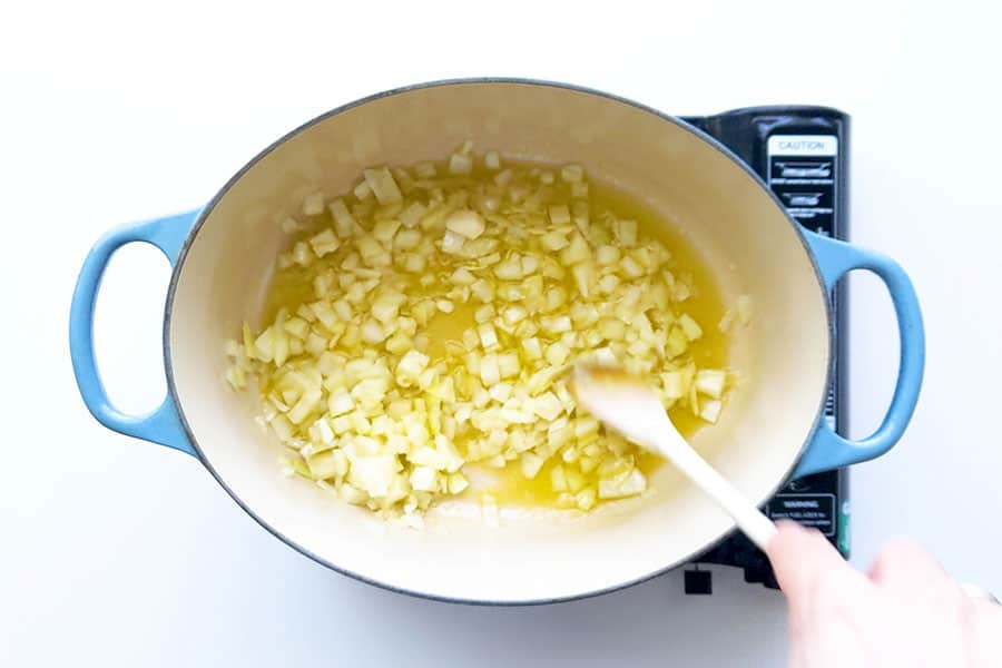 Sauteeing the onions and garlic in oil.