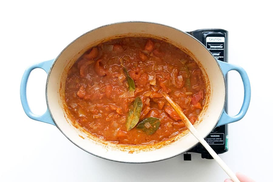 Simmering down the tomato pasta sauce over the stove.