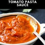 Bowl of fresh tomato pasta sauce with serving spoon.
