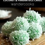 Green klepon coated in coconut on a serving board.