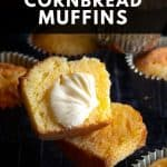 A cornbread muffin sliced in half, with a slathering of butter.