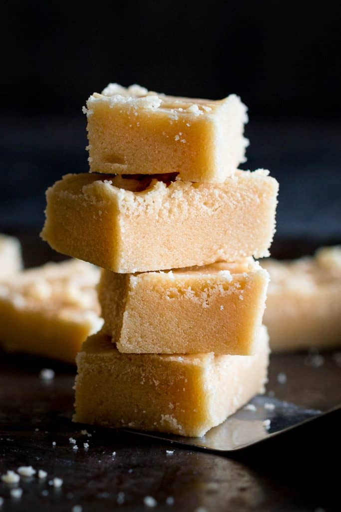 A stack of Scottish tablet slices on a tray.