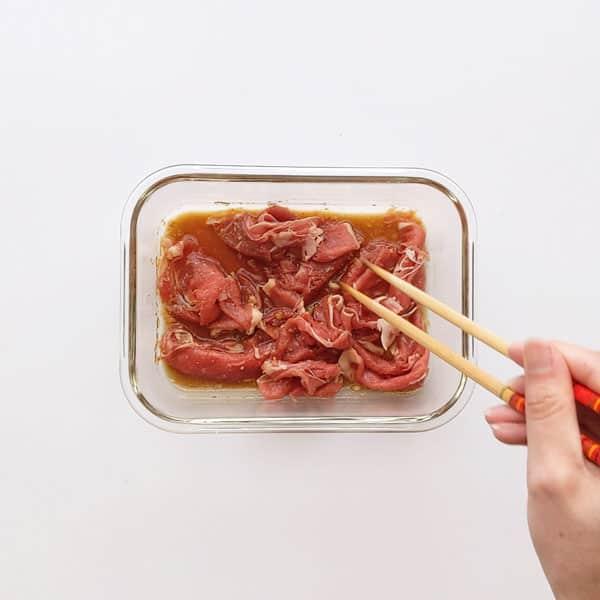 Soaking beef in Japanese marinade.