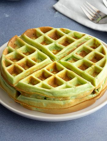 Two pandan waffles on a plate.