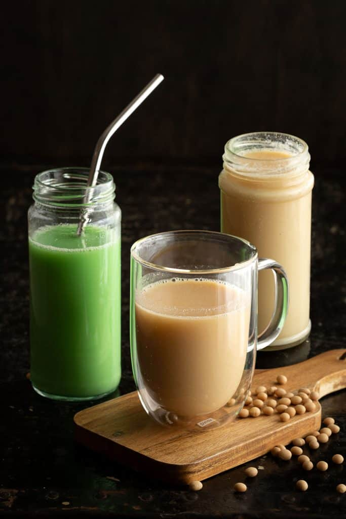 Three glasses of soy milk - original, pandan and peanut flavoured.