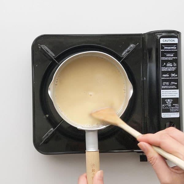 Peanut butter flavoured soy milk in saucepan.