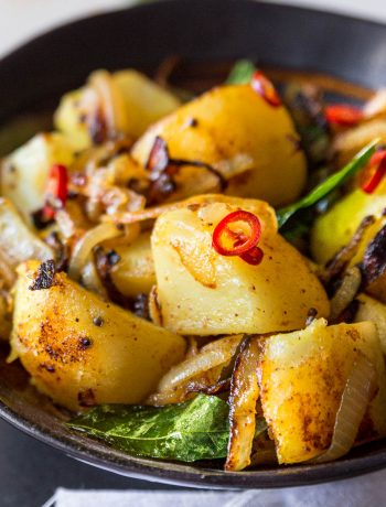Close up shot of sri lankan deviled potatoes.