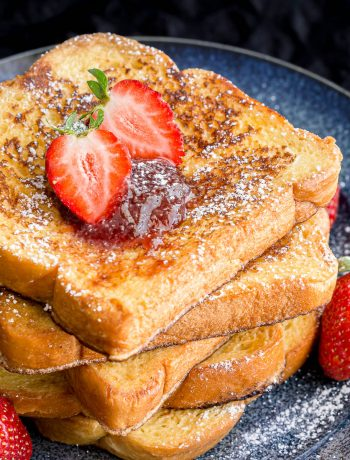 A stack of freshly cooked brioche French toast.