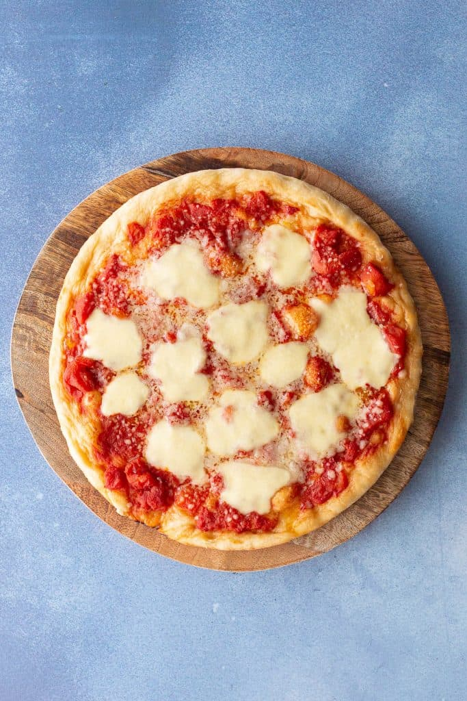 Large Italian pizza topped with mozzarella, tomato and olive oil.