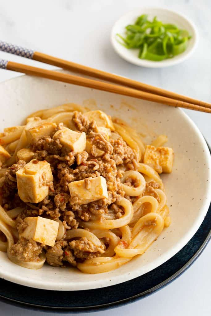 Spicy mabo tofu sauce on top of udon noodles.