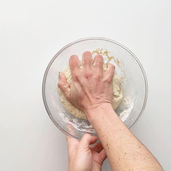 Combining flour for pizza dough.