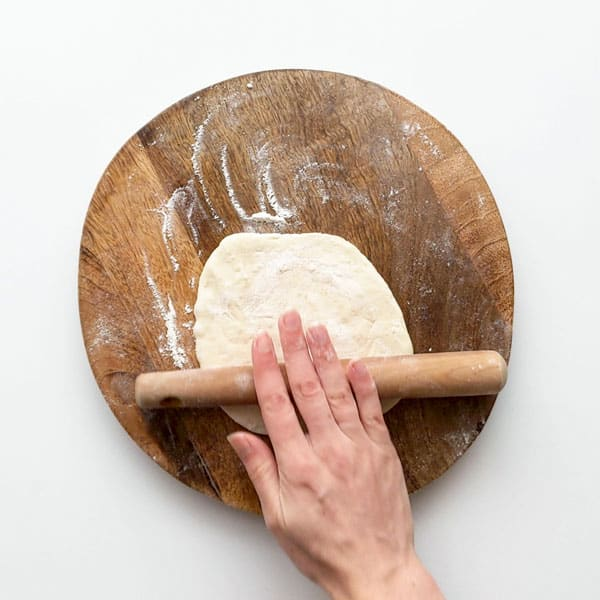Rolling out the dough bases.